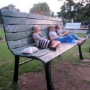 Giant Bench of Tiny People